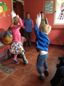 Two young children do the Chilean national dance at a senior citizen day program